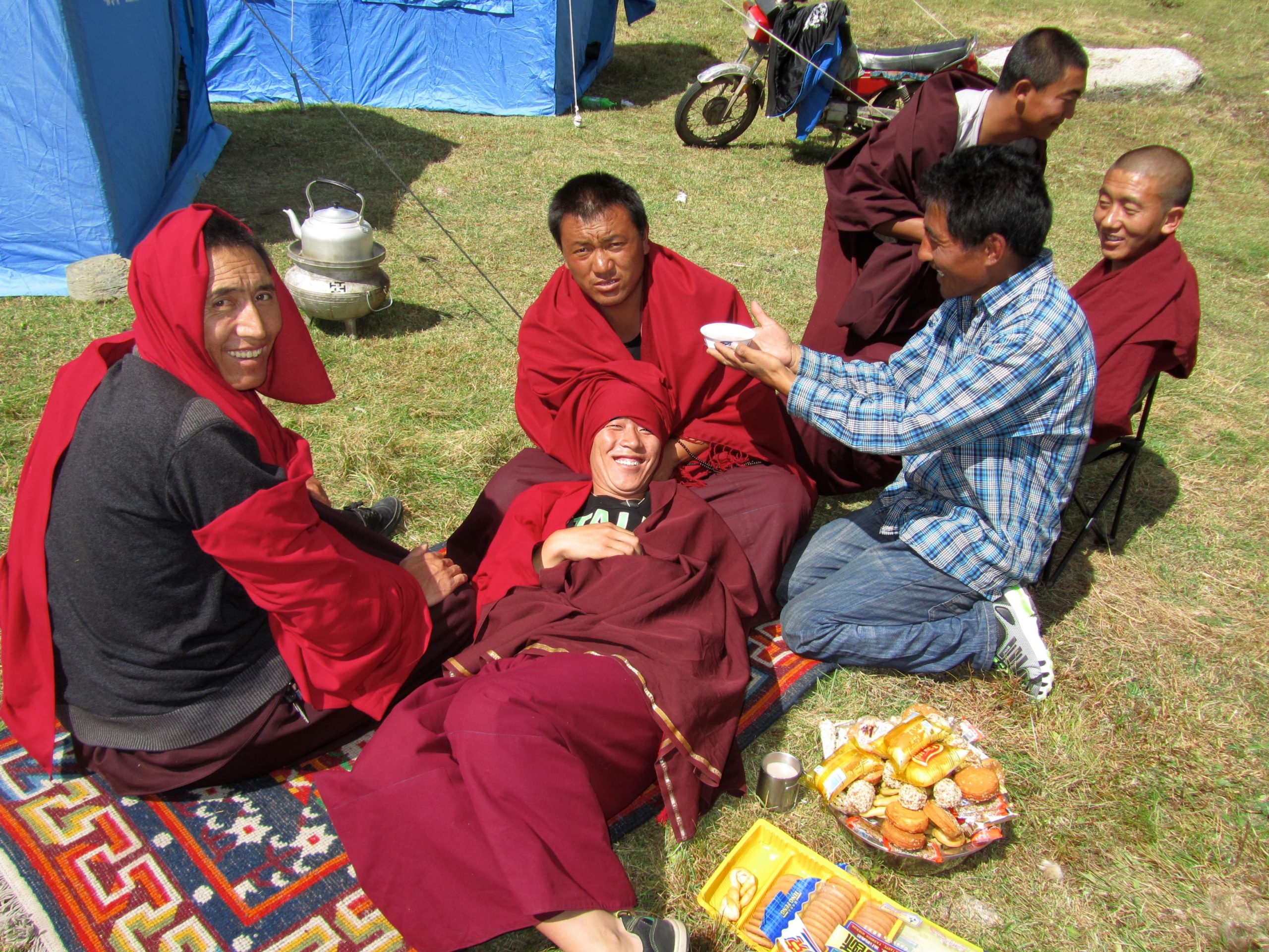 Monks on luch break at Lihun Lake, Kham