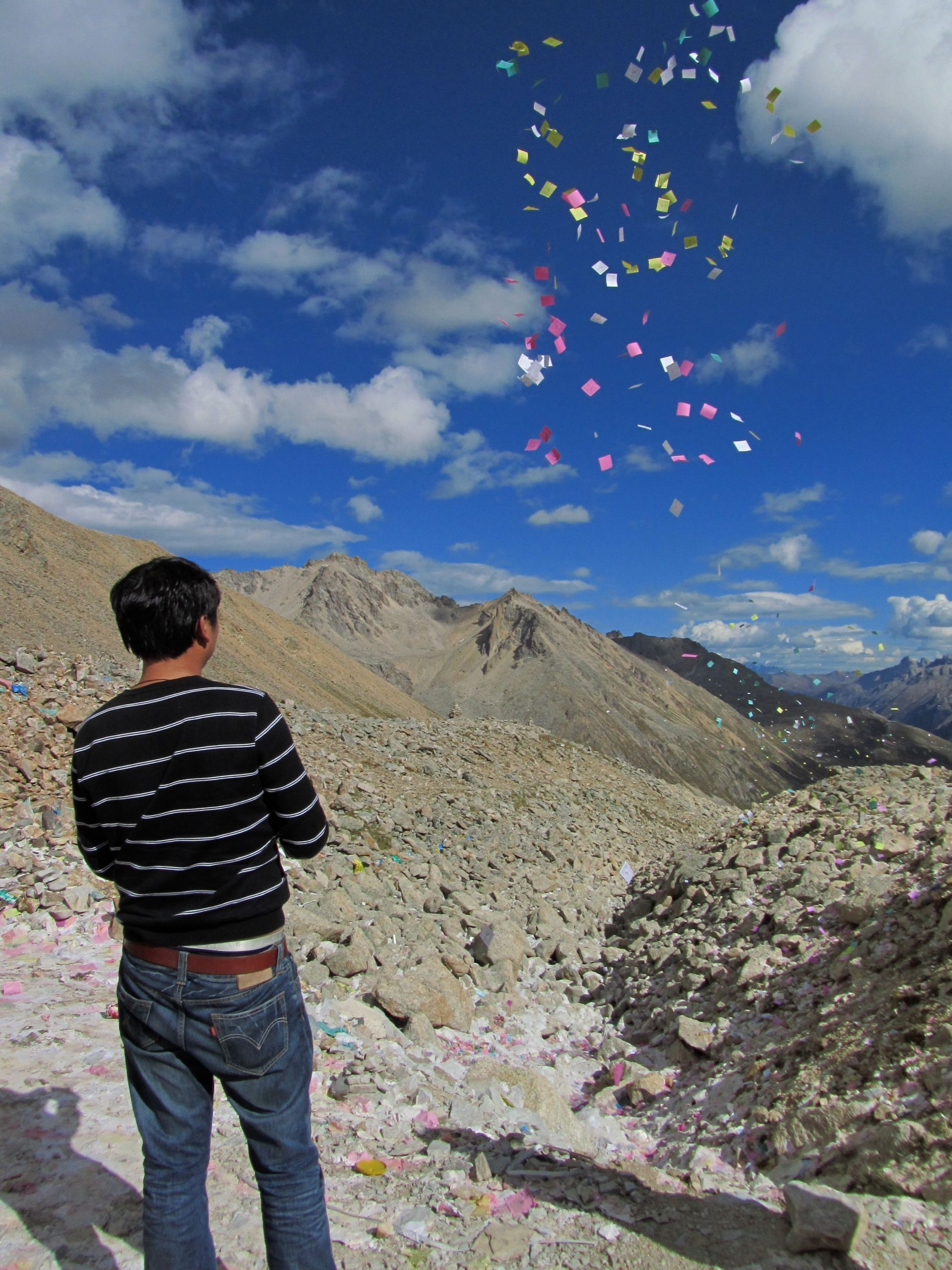 Releasing prayer slips at Chola pass, Kham